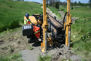 A Directbore employee operating the Horizontal Directional Drill